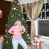 Cassie being goofy by the Christmas tree.