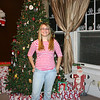 Cassie posing by the Christmas tree.