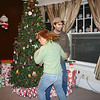 An action shot of Kim and Nathan by the tree.