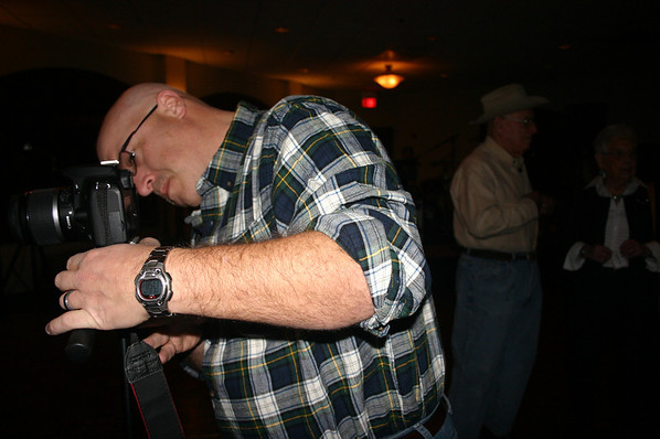 Kevin gets his camera ready to take pictures at the Lee insurance Christmas party ( 2012 )