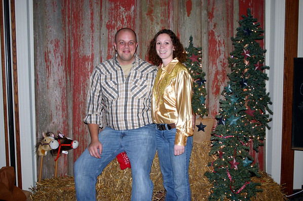 Drew and his wife at the Lee Insurance Christmas party ( 2012 )