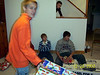 Brady, Cassie, Cory and Brock opening gifts