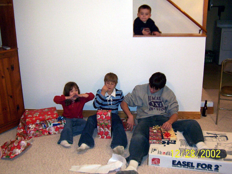 Morgan, Cassie, Cory and Brock opening gifts