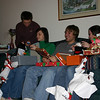 Alex, Erin and Brady are opening their gifts.