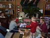 Travis Bisenius, Bryce, Elainee, Wyatt, Taylor and Travis Wolf opening christmas presents