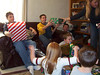 Cory, Alex, Travis Bisenius, Bryce, Elainee, Travis Wolf and Mary opening presents
