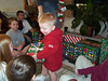 Wyatt, Travis Wolf, Elainee, Bryce and Travis Bisenius opening presents