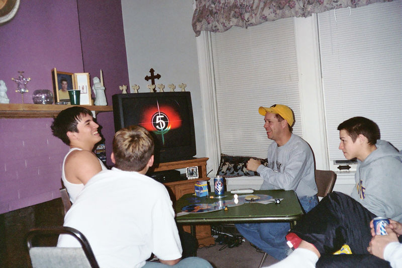 Travis Bisenius, Cory, Todd and Alex playing a game at christmas