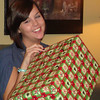 Erin gets ready to open her present  ( 2010 )