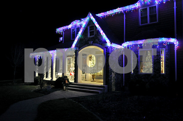 "-Messenger photo by Joe Sutter<br /> <br /> Bright hanging lights, a sign saying ""Joy"" and a festive tree greeted visitors to Diana and Mike Willerth's home on Soldier Creek Drive during the Symphony Yule Walk."