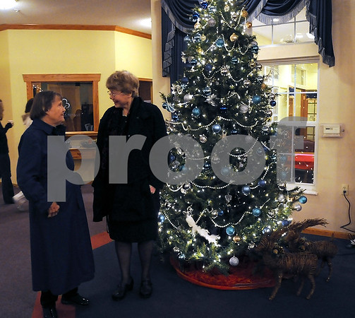 -Messenger photo by Joe Sutter<br /> <br /> Dorothy Zehr and Janet Secor talk in front of the Christmas tree and wicker deer in the lobby at Bickford Assisted Living before heading out to their next stop on the Yule Walk.