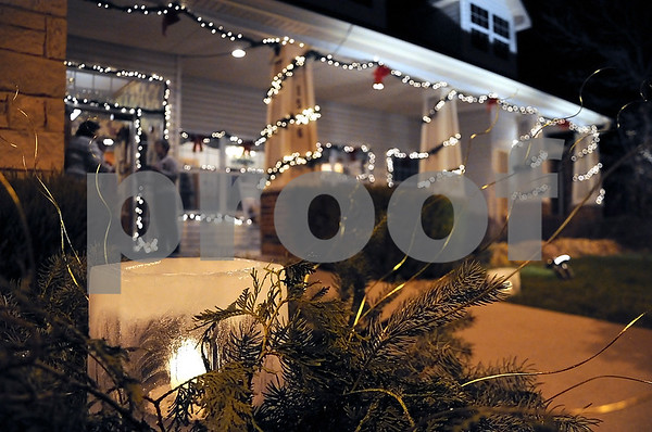 -Messenger photo by Joe Sutter<br /> <br /> Luminaries made of ice lined the walkway at Bickford Assisted Living for the Symphony Yule Walk Sunday evening. They were made by Kay Cox, whose mother lives at Bickford.