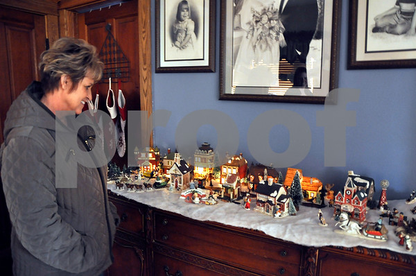 -Messenger photo by Joe Sutter<br /> <br /> Jeannie Streit, of Gowrie, looks over the model Christmas village at A.J. and Katie Dorsey's house during the Gowrie Tour of Homes. The village belongs to A.J., said Katie Dorsey. His mother would buy him a new piece for Christmas every year as he was growing up.