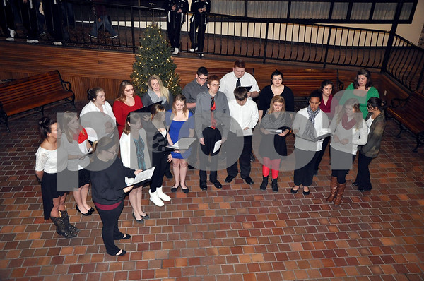 -Messenger photo by Joe Sutter<br /> <br /> The Fort Dodge Senior High choir presents songs of the season in the lower level of the Trolley Center for the Holiday on Central event. Choirs from both high schools in town performed at the event. Just down the hall from the choirs, kids could make pine cone and peanut butter bird feeders, or get a drink of hot chocolate.