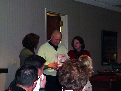 Tom and Diane open their present from the employees.
