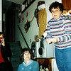 Diane Thiering, Janet and Sandy exchanging gifts