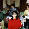 Dee, Lori, Sandy and Brenda exchanging gifts