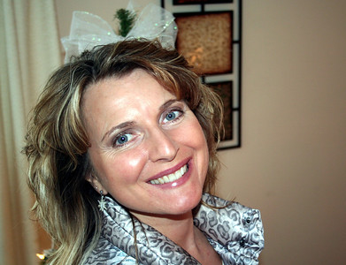 Normally you do not want to take a picture with something sticking out of the persons head.  But in this case I look cute with that bow on top of my head.  It was on the Christmas tree behind me.   Christmas 2013