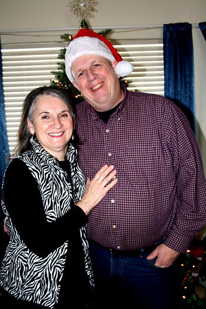 Mom & Dad in front of our tree.