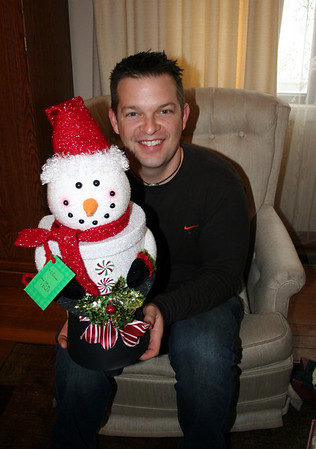 Chris really liked his snowman box.  When he opened it he found homemade lemon cookies.  Christmas 2013