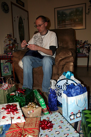 Patrick opening up his gifts from me. Christmas Eve 2010