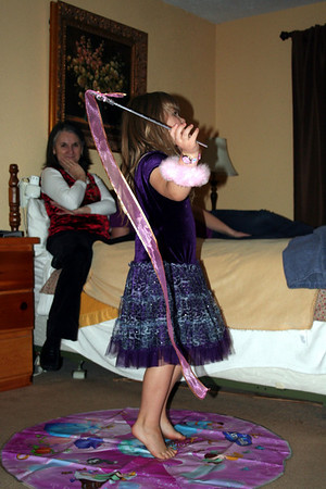 We had got the girls a Disney Dance along DVD.  Anissa doing one of the dance moves.