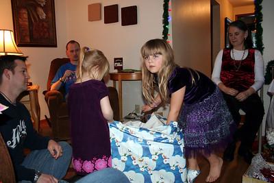 Anissa & Makenna opening up the gift from Uncle Pat, Aunt Melissa, Papa Peak, & Uma Peak.