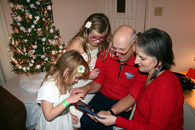 """One of the gifts from Chris & Lorinda was a """"brag"""" book with pictures of the girls thru the years.  They really loved looking at the pictures.  Christmas 2013"""
