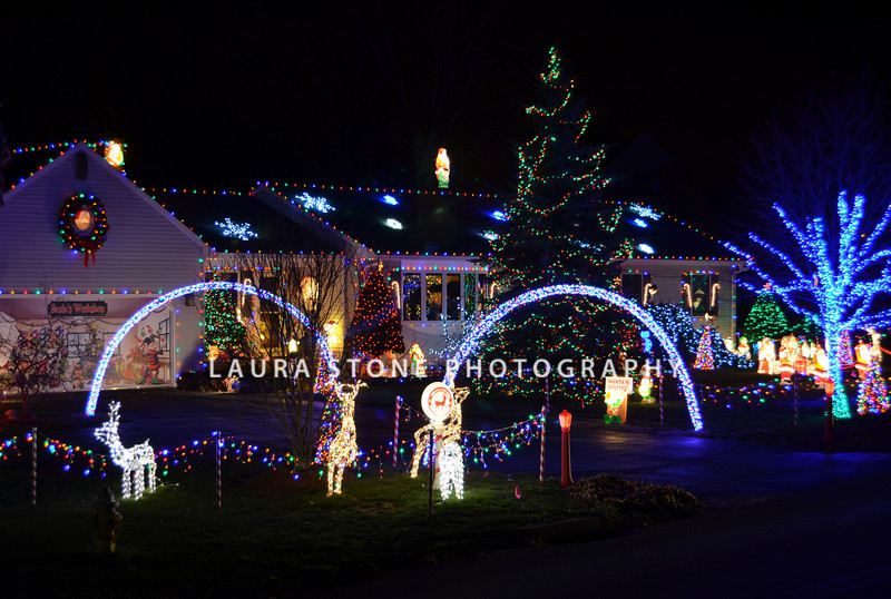 A house decorated with lights and lawn ornaments for the Christmas holiday