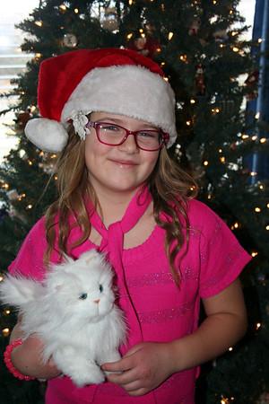 Anissa poising with Papa Peaks Santa hat.    Christmas 2013