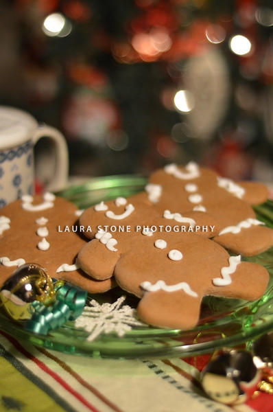 Gingerbread cookies and a cup of hot cocoa with holiday lights in the background