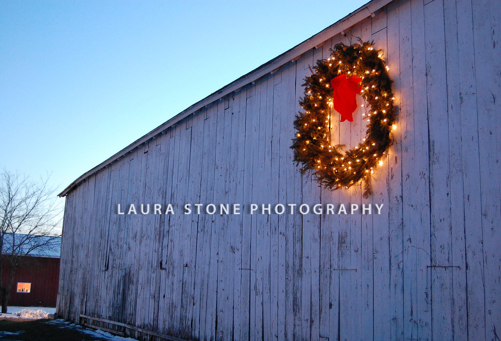 A holiday wreath on the side of an old barn in Ellington, CT.