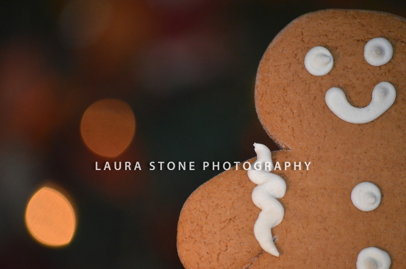 Close-up of a gingerbread cookie with Christmas lights in the background. Copy space.