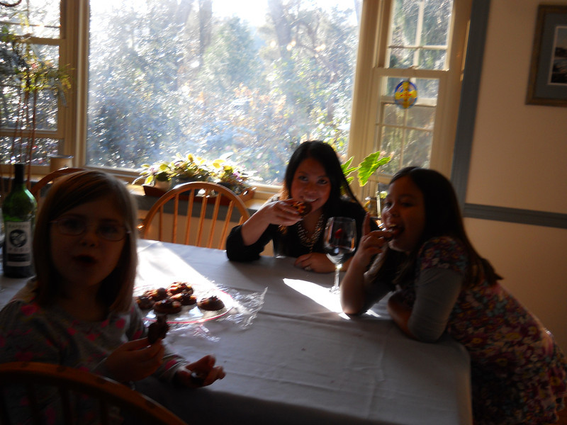 "Leonie, Kaidyn and Anna enjoying ""turkey"" cookies"