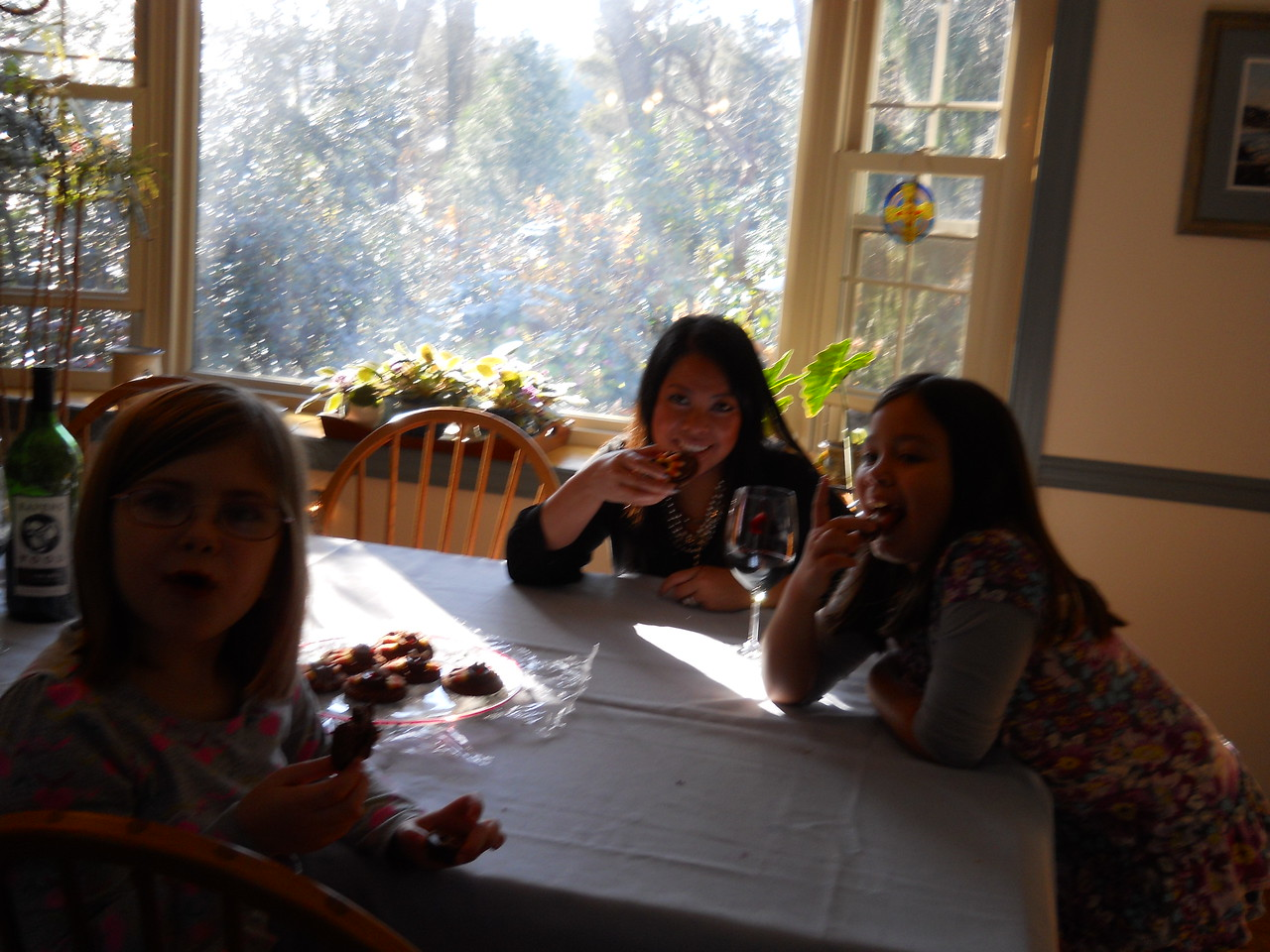"Leonie, Kaidyn and Anna enjoying ""turkey"" cookies"