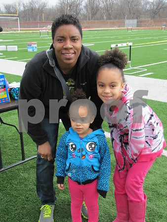 G Myers with her children Rihanna and Mariah Myers before the Easter Egg Hunt began.