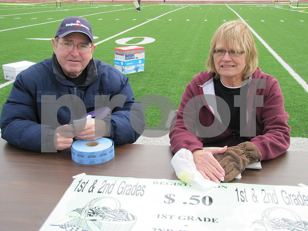 Mike Spencer and Shirley Weimer selling tickets at the Moose's annual Easter Egg Hunt.