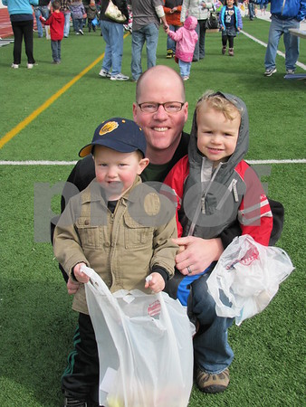 Ryan Riesner with his son Calahan, and Jake Bockes before the Easter Egg Hunt at Dodger Stadium.