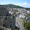 June 2011. Conwy Castle, Wales. Looking out over the town. The walls that encircle the old town can be clearly seen in the distance.