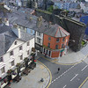 June 2011. Caernarfon, Gwynedd, Wales. The town and part of the town walls from the castle ramparts.