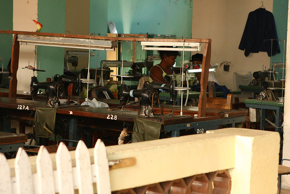 Factory looking like a hangar with lots of sewing desks.