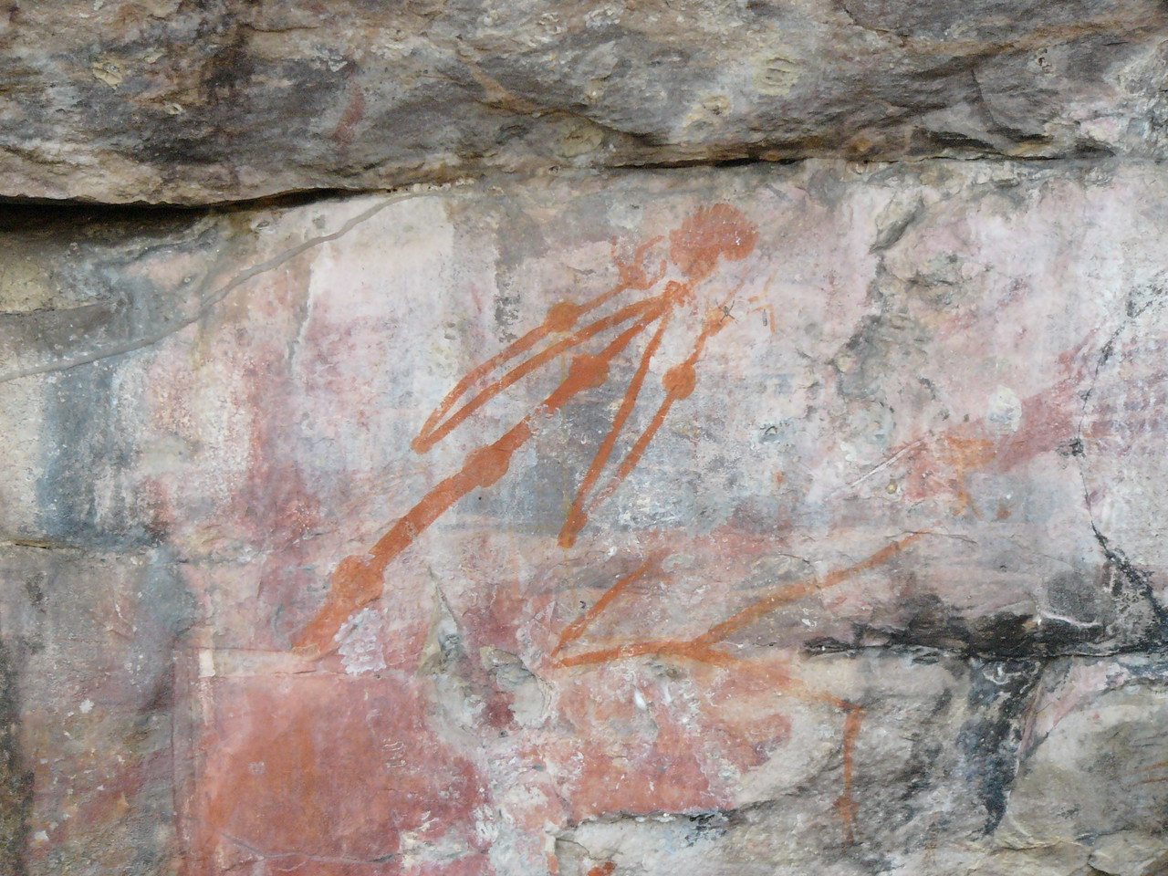This aboriginal rock paintings depicts an ill person with swollen joints. The accompanying explanation board states that the illness is 'miyamiya'. This illness afflicts people who disturb a sacred site near the East Alligator River.