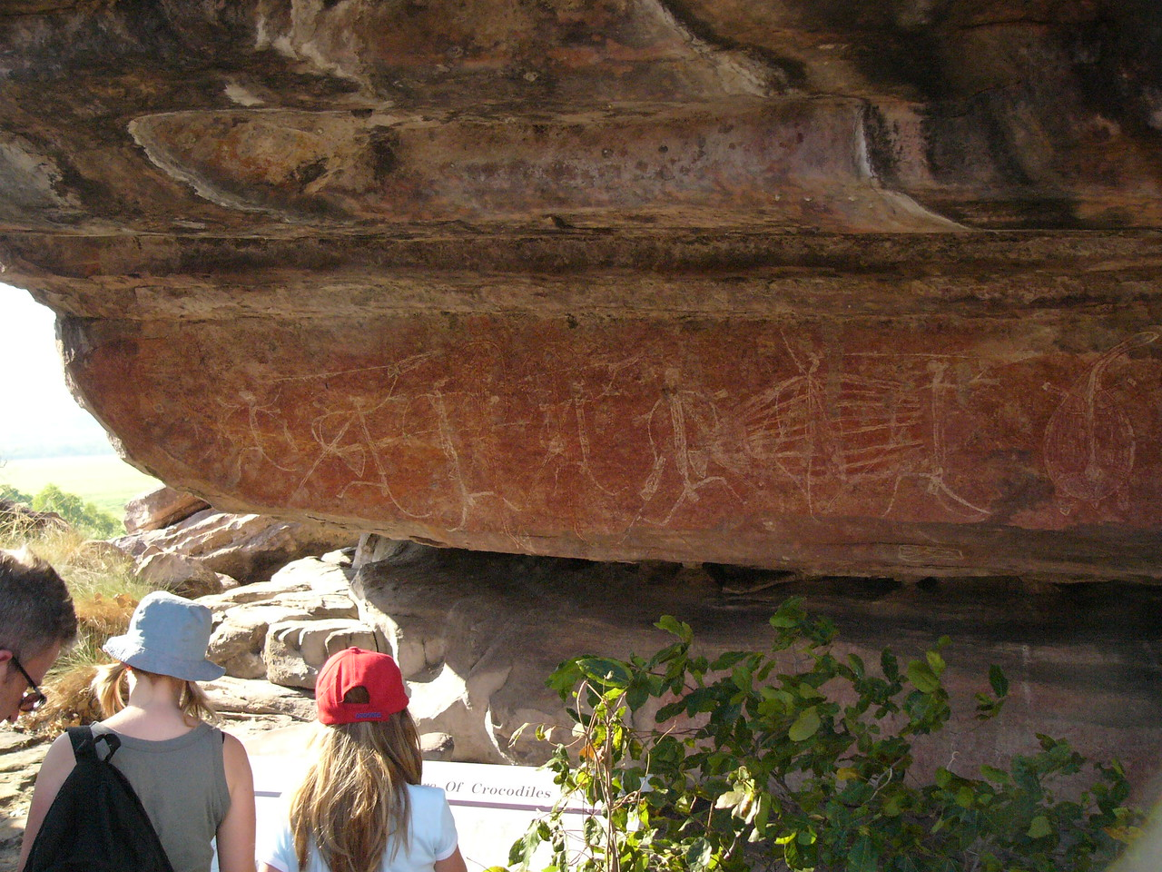 Aboriginal rock painting at Ubirr, Kakadu National Park. This rock painting depicts a 'dream-time' story of two sisters, the Namarkan sisters, who could turn into crocodiles (and back into humans) at will. They could then play tricks on people, scaring them out of their wits. Unfortunately, they then stayed crocodiles. Their spirit is in each crocodile, giving the crocodiles a mischievous glint in their eyes. Their spirits can also reach into people with something like strings, causing illness.
