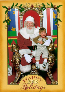 Garrett's first picture with Santa.  Those are real crocodile tears!