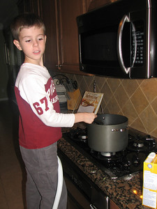 Tyler enjoys helping out in the kitchen.  And he is actually becoming pretty good at it thanks to all the cooking they do at school.