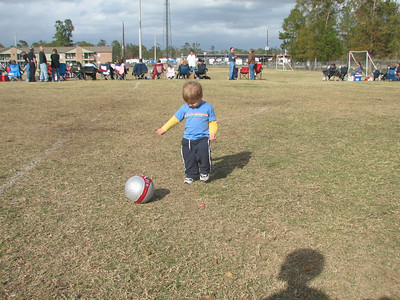 Garrett enjoys kicking the ball too.  He's pretty good at it for an 18 month old.