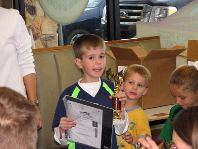 Tyler getting his soccer trophy and pictures.