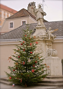 December Photo a Day - Day 14 - Christmas Tree  Just one of many decorated Christmas trees on the streets in Melk, Austria. It was very common throughout Central Europe to have decorated trees outside.