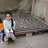 Jiya and Reya sitting on a maze game for to be princes and queens maybe :)