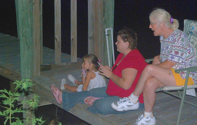 "Three generations----grandmother, mother, daughter----watching Fireworks together.  It was but ""moments"" ago that this grandmother was the daughter sharing these events with her mother and grandmother."